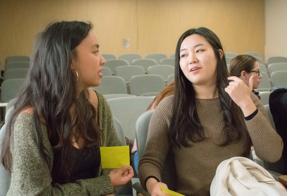 Two students at Santa Monica College, Bianca Austria (left), who speaks English and Tagalog talks with Yoori Kwak (right), who speaks Korean greet each other during an orientation for the Language and Culture Exchange program in Santa Monica, California on Thursday, March 8, 2018. The program allows students wishing to practice speaking different languages to match up with others and is free for students and is operated through Canvas. (Photo by Ethan Lauren)