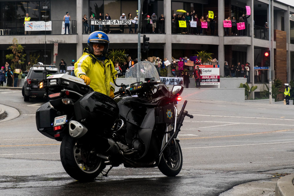 A California Highway Patrol Officer waits for his signal to lead the way for President Donald Trump and the rest of his party on Tuesday, March 13, 2018 in Santa Monica, California. (Photo By: Zane Meyer-Thornton)