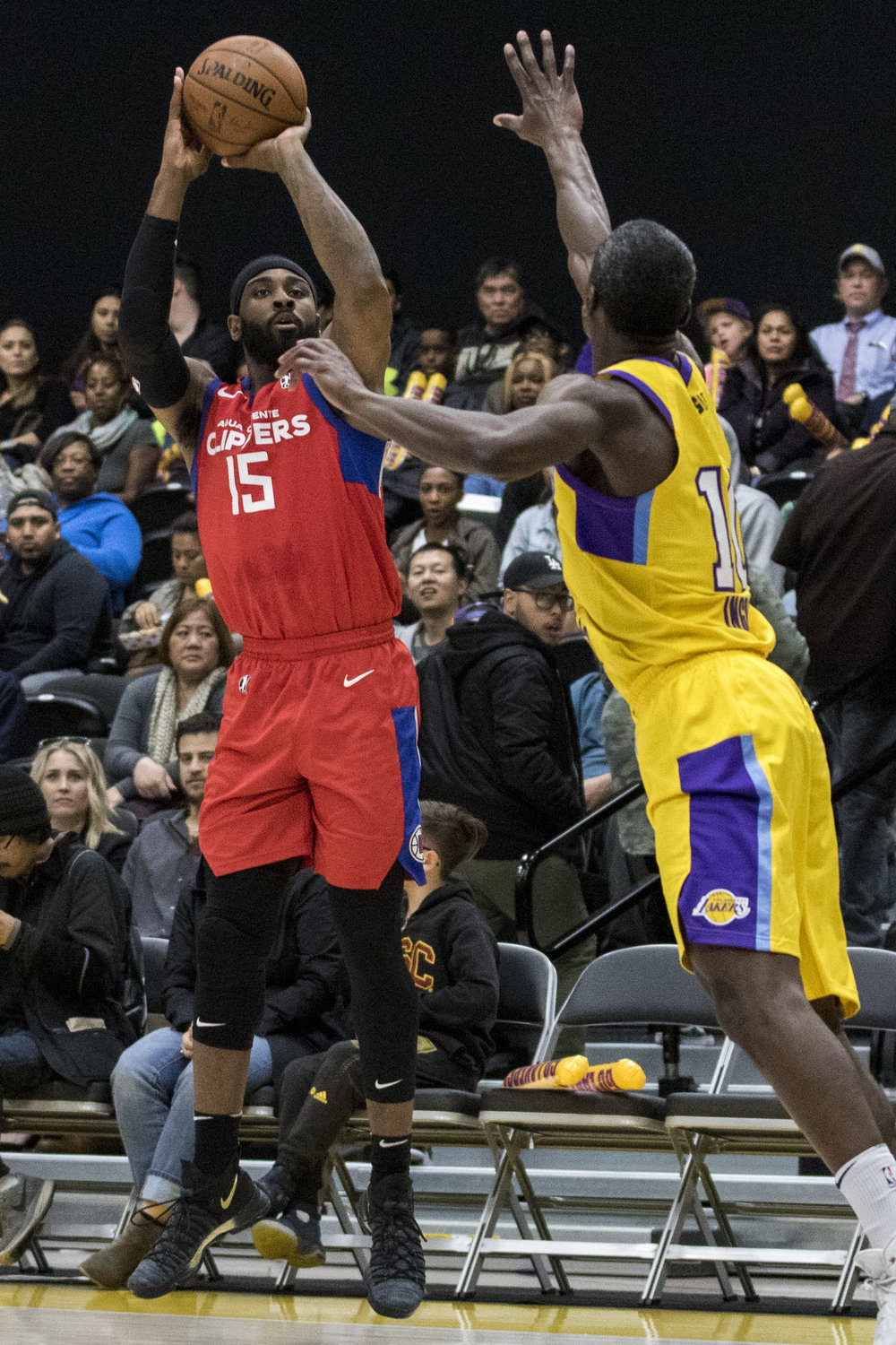 Agua Caliente Clippers forward LaDontae Henton (15, left) shoots a 3 point shot while South Bay Lakers guard Andre Ingram (10, right) contests it during their Gatorade League game on March 16, 2017 at the UCLA Health Stadium in El Segundo,California. The Lakers won 108-104. (Zane Meyer-Thornton/Corsair Photo)