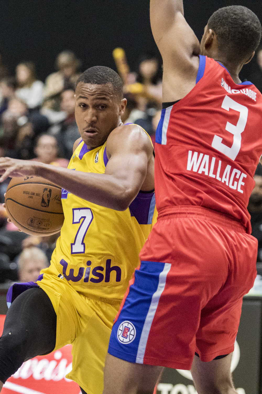 South Bay Lakers guard Demarcus Holland (7, left) drives by Agua Caliente Clippers guard Tyrone Wallace (3, right) during their Gatorade League game on March 16, 2017 at the UCLA Health Stadium in El Segundo, California. The Lakers won 108-104. (Zane Meyer-Thornton/Corsair Photo)