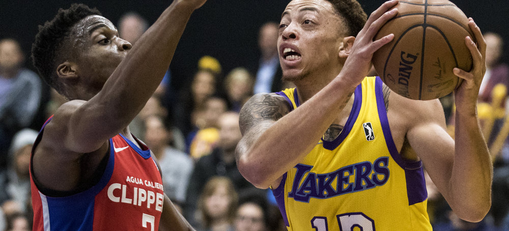 South Bay Lakers forward Stephaun Branch (13, right) shields the ball from Agua Caliente Clippers guard Ike Iroegbu (2, left) during their Gatorade League game on March 16, 2017 at the UCLA Health Stadium in El Segundo,California. The Lakers won 108-104. (Zane Meyer-Thornton/Corsair Photo)