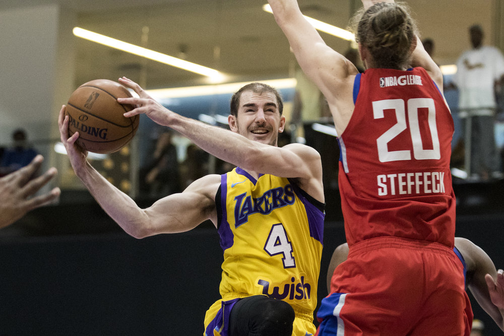 South Bay Lakers guard Alex Caruso (4, left) drives to the hoop past Agua Caliente Clippers forward Keith Steffeck (20, right) during their Gatorade League game on March 16, 2017 at the UCLA Health Stadium in El Segundo,California. The Lakers won 108-104. (Zane Meyer-Thornton/Corsair Photo)