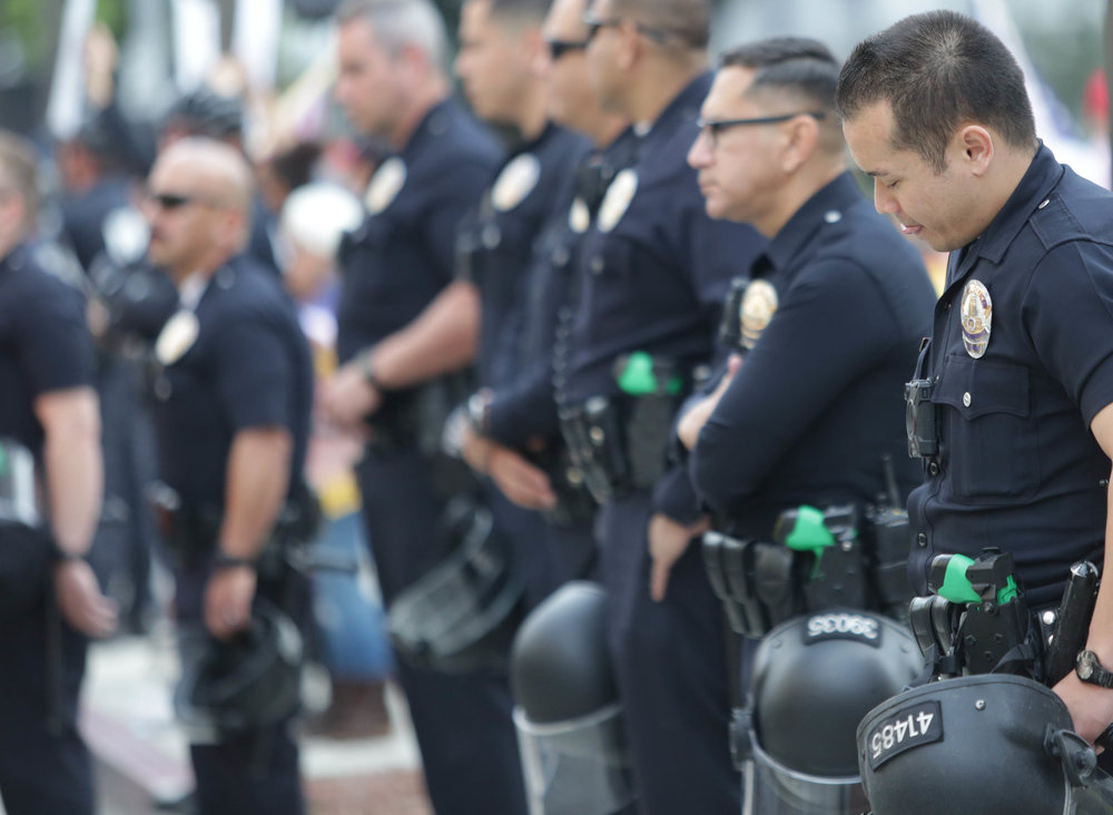 Police line up prepared for the worst seperating protesters and counter protesters on either side of them. Crowds gathered to support their respective belief at the March for Life in Downtown Los Angeles, California. The Demonstration took place on Saturday, March 24, 2018. (Corsair Photo/ William Wendelman)