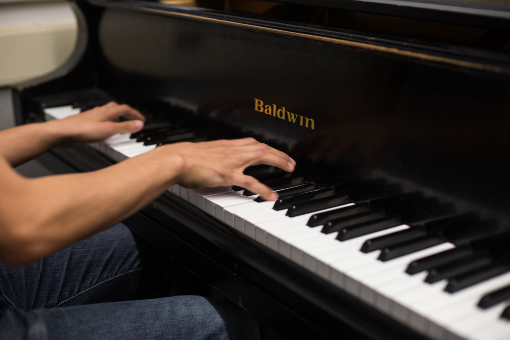 President of Santa Monica College's (SMC) Music Appreciation Club,  Leonardo Rodriguez plays some tunes on the piano, Thursday, March 22, 2018, at SMC's Performance Arts Center in Santa Monica, California (Zeynep Abes/ Corsair Photo)