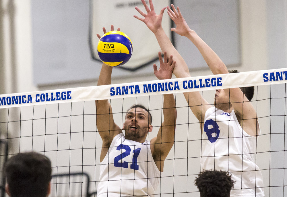 The Santa Monica College Corsair defense consisting of setter Hunter Douglas #21 (left, white) and middle-hitter Nick Kostetsky #8 (right, white) prepare for the incoming spike from the Los Angeles Trade Tech Beaver offense during the Corsairs 3-0 blowout victory against the Tech Beavers in the Santa Monica College (SMC) Pavilion at the SMC main campus in Santa Monica California, on Friday, March 30 2018. (Matthew Martin/Corsair Photo)