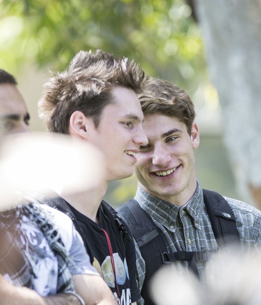 """Santa Monica College Associated Student (A.S) Director of Sustainability candidate Joseph """"Joe"""" Kolko (right) talks with a friend as the A.S election debate takes place debate on the quad of the Santa Monica College main campus in Santa Monica California, on Tuesday, April 3, 2018. (Matthew Martin/Corsair Photo)"""