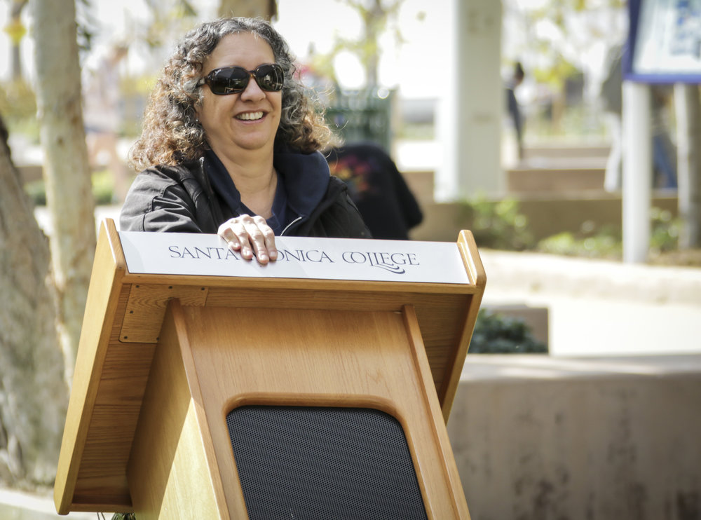 Santa Monica College event technician Carol Evans placing the podium for the Associated Students candidates before the AS elections debate held at the quad of the main campus in Santa Monica, California, Tuesday, April 3, 2018. (Ashutosh Bikram Singh/Corsair Photo)