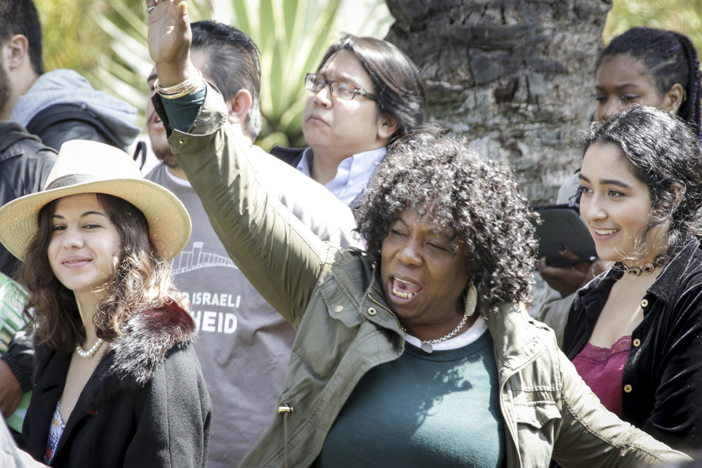 Santa Monica College student Hyacinth Mcleod (Middle) cheers as the candidates deliver their speeches while at the Associated Students elections debate held at the quad of the main campus on Tuesday April 3, 2018. (Santa Monica, California, Tuesday April 3, 2018.) (Ashutosh Bikram Singh/Corsair Photo)