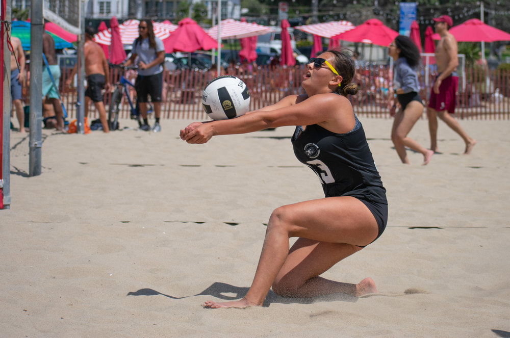 Santa Monica College Corsair Ada Nadzakova (#13) sets the ball for Taylor Burks (#12, not pictured) during a conference game of beach volleyball in court two  against the Bakersfield College Knights at the Santa Monica beach on Friday, April 13, 2018 in Santa Monica, California. It was a 5-0 loss for the Corsairs, bringing their total to 2-12 for the season. (Ethan Lauren/Corsair Photo)