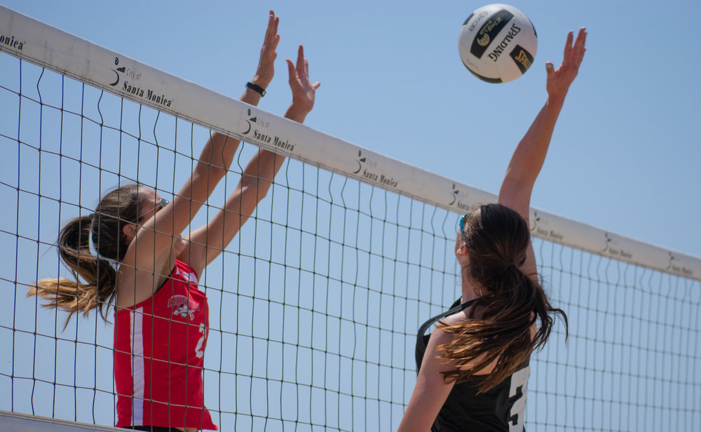 Santa Monica College Corsair Ada Nadzakova (#13) attempts to defend against the Bakersfield College Knights during a conference game of beach volleyball in court two at the Santa Monica beach on Friday, April 13, 2018 in Santa Monica, California. It was a 5-0 loss for the Corsairs, bringing their total to 2-12 for the season. (Ethan Lauren/Corsair Photo)