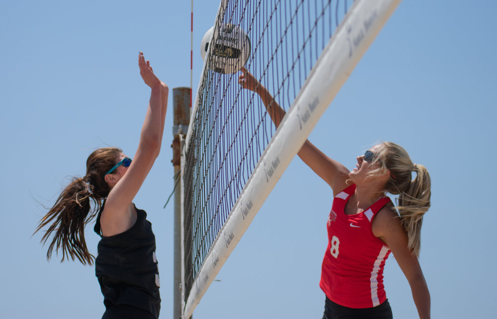 Santa Monica College Corsair Chelsea Bostwick (#13) attempts to defend during a conference game of beach volleyball in court one against the Bakersfield College Knights at the Santa Monica beach on Friday, April 13, 2018 in Santa Monica, California. It was a 5-0 loss for the Corsairs, bringing their total to 2-12 for the season. (Ethan Lauren/Corsair Photo)