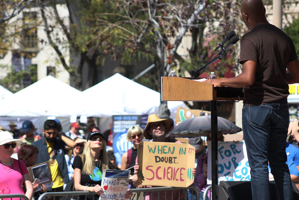 Malik Ducard, global head of family and learning for Youtube, speaks to the crowd at the LA March for Science in Pershing Square, Los Angeles, California, on Saturday, April 14, 2018. (Pyper Witt/ the Corsair)