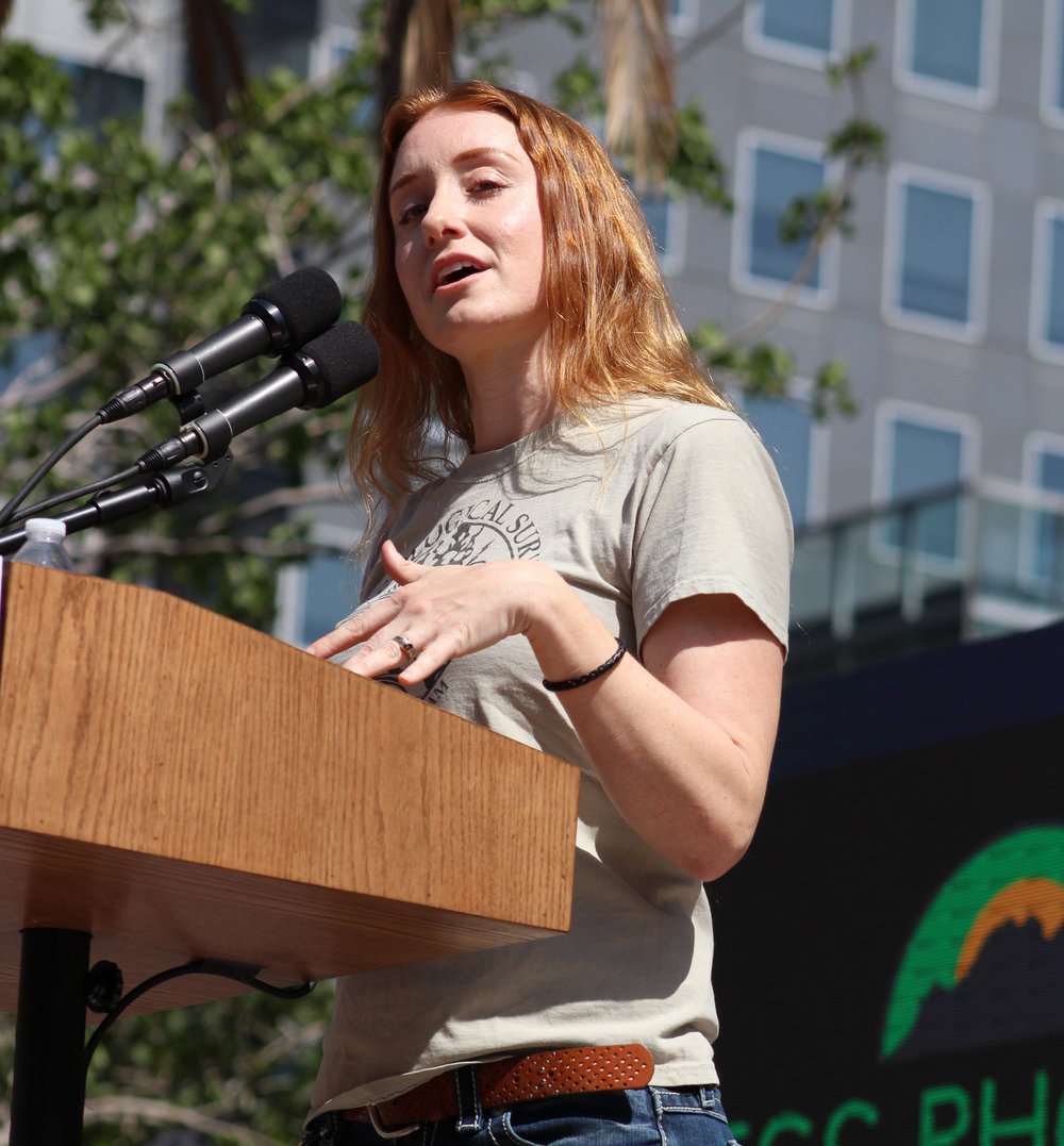 """Jess Pheonix, volcanologist, geologist, and executive director/co-founder of nonprofit environmental  research organization Blueprint Earth, discusses how """"anyone can be a scientist,"""" at  the LA March for Science in Pershing Square, Los Angeles, California, on Saturday, April 14th, 2018. (Pyper Witt/ the Corsair)"""