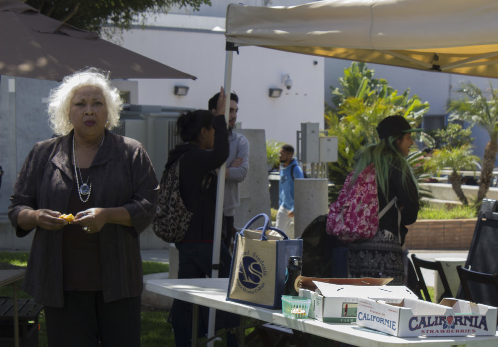 Dr. Kathryn Jeffery (left), President of Santa Monica College, attended the morning Farmers Market. Earth Week started with 'Students Feeding Students' Free Farmers Market & Food Demos on Monday, April 16, 2018. At Santa Monica College, Santa Monica California. (Emeline Moquillon/Corsair Photo)