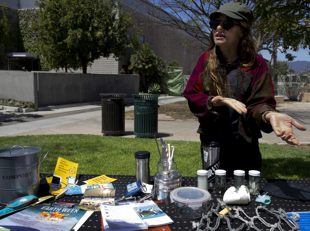 Bronwyn Major, President of Plastic SMC, major in Environmental studies, demonstrated reusable ustensiles and  told students how to cut down on plastic waste. Earth Week started with 'Students Feeding Students' Free Farmers Market & Food Demos on Monday, April 16, 2018. At Santa Monica College, Santa Monica California. (Emeline Moquillon/Corsair Photo)