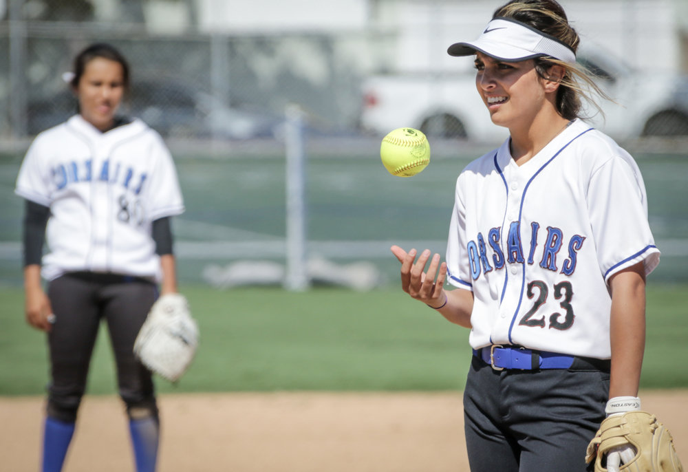 Santa Monica College Corsair softball team pitcher Taylor Liebesman taking a moment to throw her pitch as her teammate looks on during their game against Oxnard  College on thursday, April 19th, 2018. The game ended 3-2 in favor for Santa Monica College. (Santa Monica, California, Thursday April 19th, 2018) (Ashutosh  Bikram Singh/Corsair Photo)