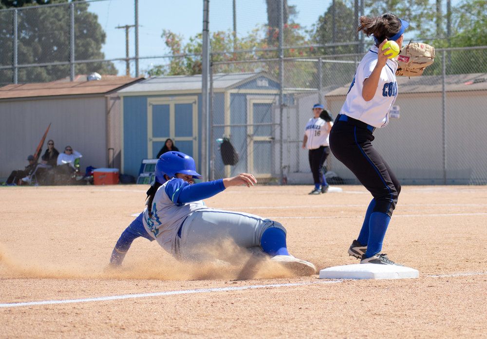 After forcing the Oxnard Condors out of third base, Santa Monica College Corsair Briana Osuna (#10) throws the ball to first to get the next runner out ball in a softball on Thursday, April 19, 2018 at the John Adams Middle School Field in Santa Monica, California. The game ended with an 3-2 win for the Corsairs, breaking a seven-game losing streak on their penultimate game of the season. (Ethan Lauren/Corsair Photo)