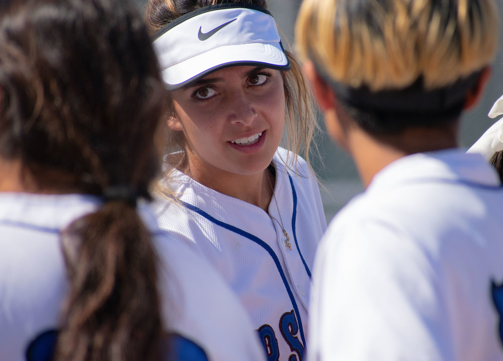 Santa Monica College Corsair Taylor Liebesman (#23) talks with several players on the field during the sixth inning of a softball game against the Oxnard Condors on Thursday, April 19, 2018 at the John Adams Middle School Field in Santa Monica, California. The game ended with an 3-2 win for the Corsairs, breaking a seven-game losing streak on their penultimate game of the season. (Ethan Lauren/Corsair Photo)