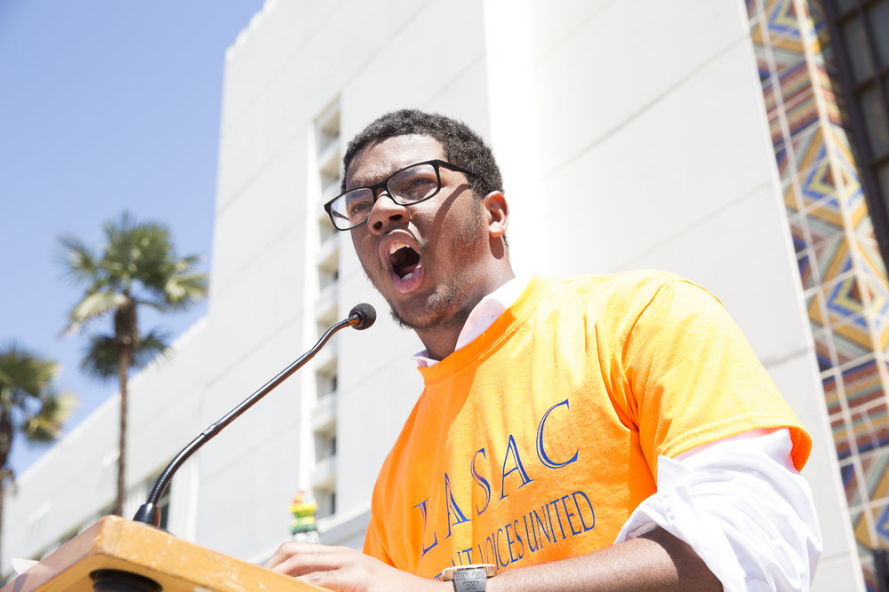 "Cameron Roger, a senior at University High school, speaks at Santa Monica City Hall to hundreds of students who have ""walked out"" of school to protest all forms of gun violence in Santa Monica California on Friday, April 20 2018. Rogers walked nearly 4 miles to attend the protest that converged at Santa Monica City Hall (Matthew Martin/Corsair Photo)"