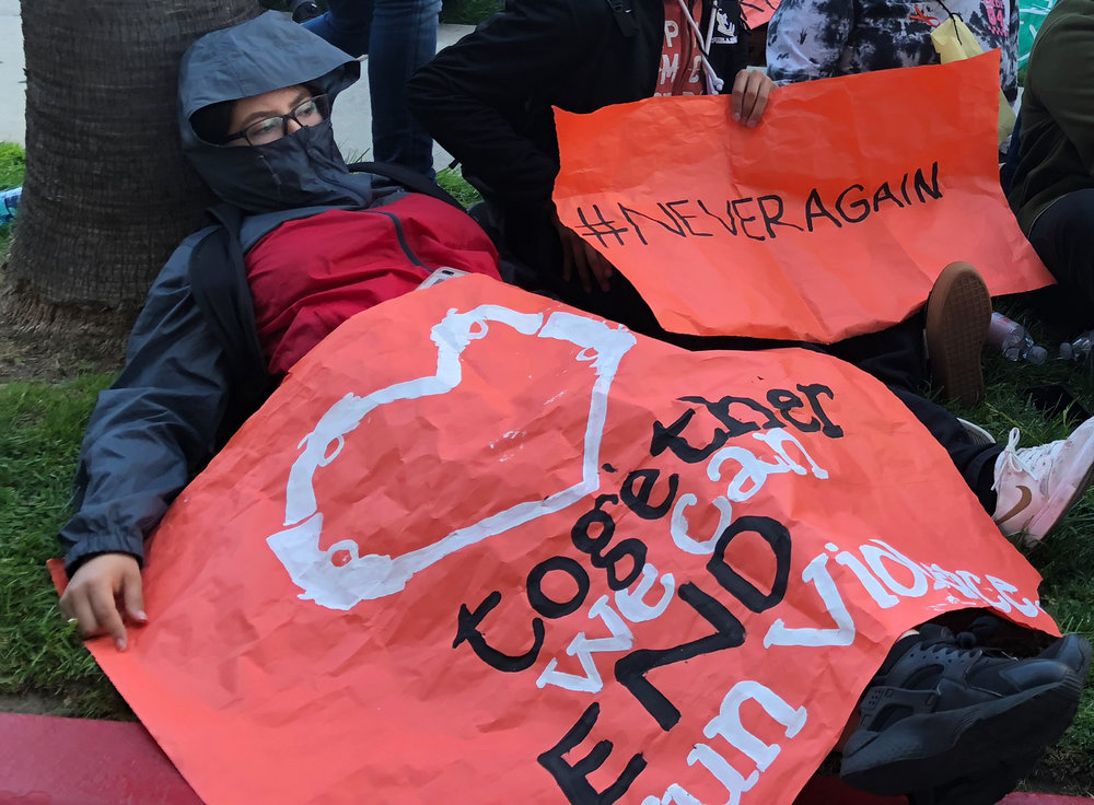 Students gather and sit in front of the Los Angeles Unified School District headquarters to protest for gun reform, in downtown Los Angeles, California. on Friday, April 20, 2018. (Ryanne Mena/ Corsair Photo)