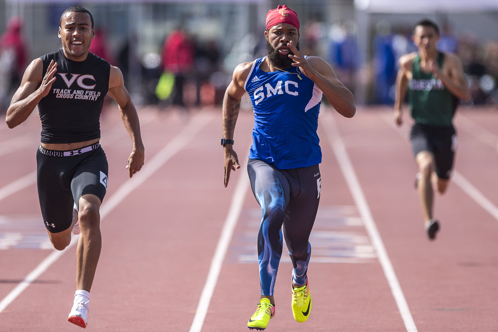 Santa Monica College (SMC) student athlete Jordon Herrera (center) speeds toward the finish line during heat 1 of the men's 200-meter dash at the Track and Field Western State Championships at the SMC Corsair Stadium in Santa Monica California on Friday April 20 2018. (Matthew Martin/Corsair)
