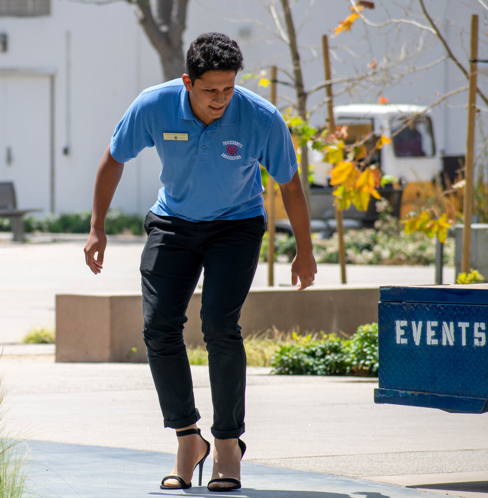Francisco Rubio Hernandez puts on high heels to march at Santa Monica College in solidarity for women during an event regarding sexual awareness at Santa Monica College on Tuesday, April 24 in Santa Monica, California and organizes high heels. The day was aimed towards men, who were encouraged to take a pledge about speaking up to sexual abuse and later were given high heels to walk around the campus. (Ethan Lauren/Corsair Photo)