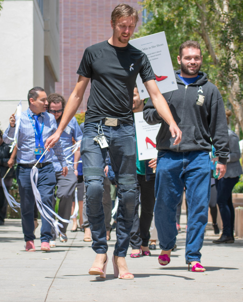 Tanner Jordan walks in front during a march for an event to show solidarity to women at Santa Monica College on Tuesday, April 24 in Santa Monica, California. The day was aimed towards men, who were encouraged to take a pledge about speaking up to sexual abuse and later were given high heels to walk around the campus. (Ethan Lauren/Corsair Photo)