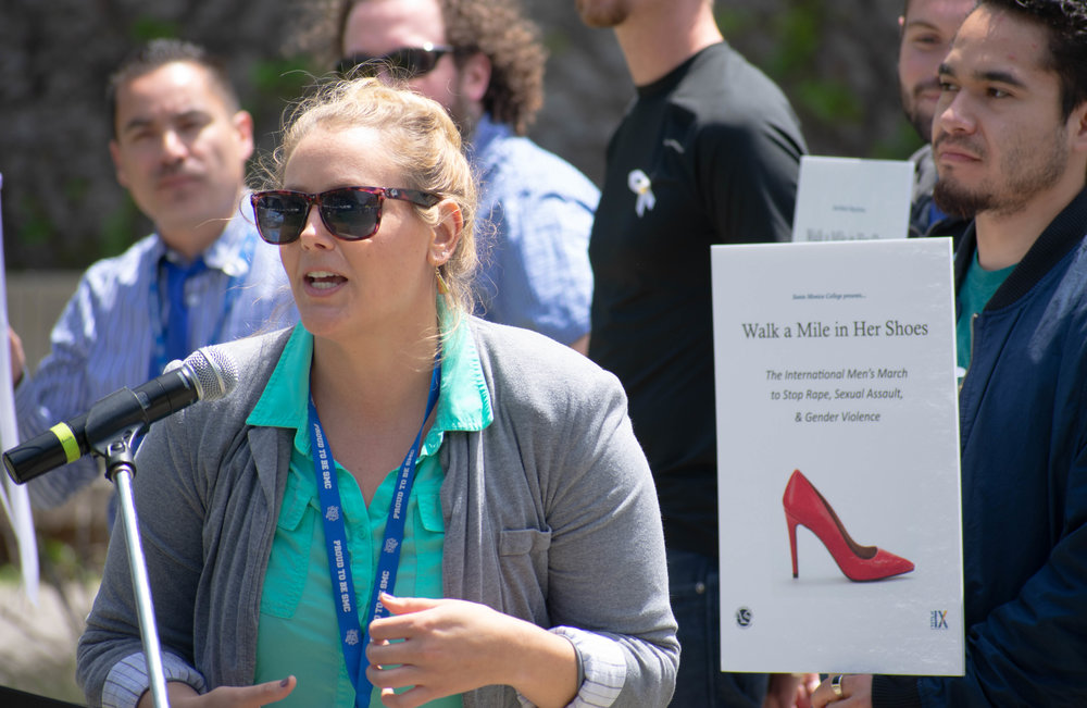 Rebecca Weiland, a title IX deputy at Santa Monica College thanks everybody who participated during an event regarding sexual awareness at Santa Monica College on Tuesday, April 24 in Santa Monica, California and organizes high heels. The day was aimed towards men, who were encouraged to take a pledge about speaking up to sexual abuse and later were given high heels to walk around the campus. (Ethan Lauren/Corsair Photo)