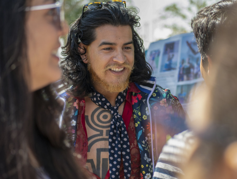 Cesar Sanchez represents Le Club Francophone on campus during Club Row on Thursday, April 26, 2018 at Santa Monica College in Santa Monica, California. With over 60 clubs in attendance, the day is meant to encourage clubs to showcase what they've been doing over the semester for students. (Ethan Lauren/Corsair Photo)