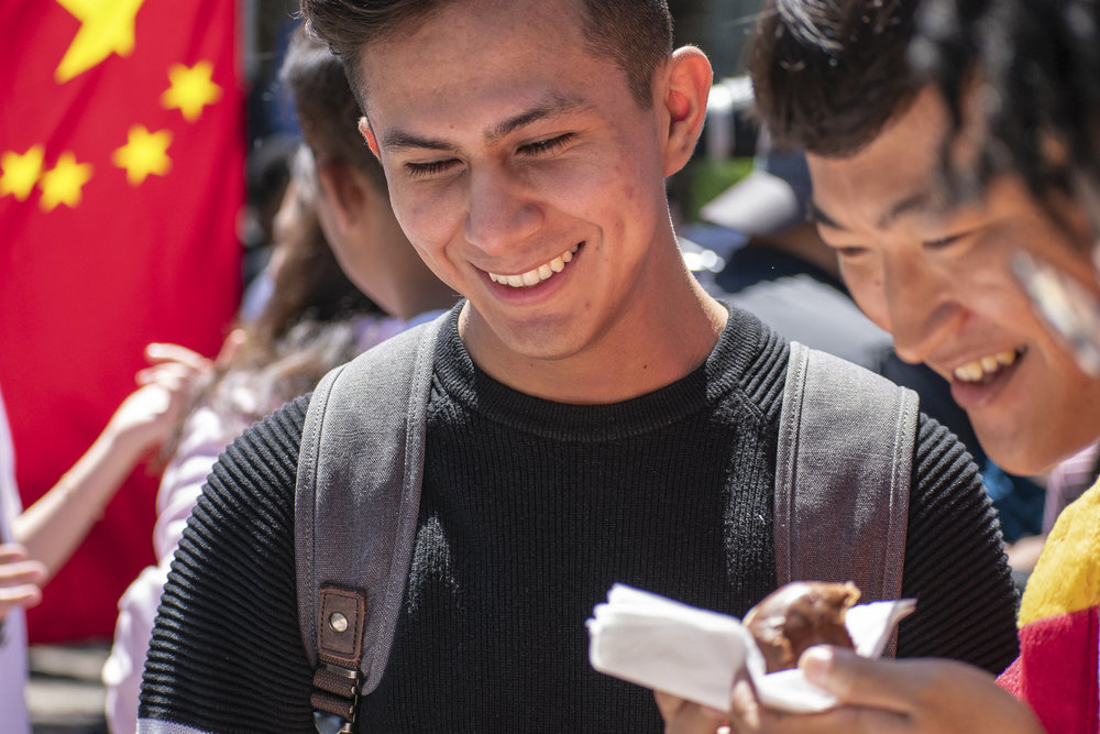 On the quad at Santa Monica College, Daniel Garcia visits the Asian Culture Exchange Association during Club Row on Thursday, April 26, 2018 in Santa Monica, California. With over 60 clubs in attendance, the day is meant to encourage clubs to showcase what they've been doing over the semester for students. (Ethan Lauren/Corsair Photo)