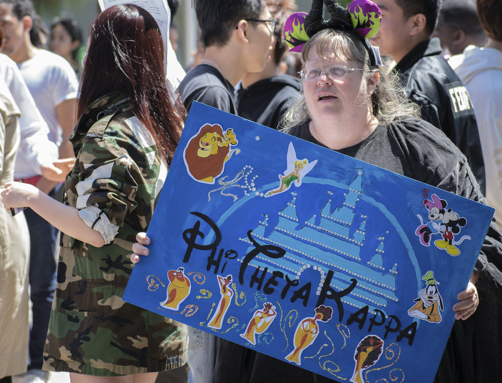 LeAnn Bogart advertises the honor society Phi Theta Kappa on campus during Club Row on Thursday, April 26, 2018 at Santa Monica College in Santa Monica, California. With over 60 clubs in attendance, the day is meant to encourage clubs to showcase what they've been doing over the semester for students. (Ethan Lauren/Corsair Photo)