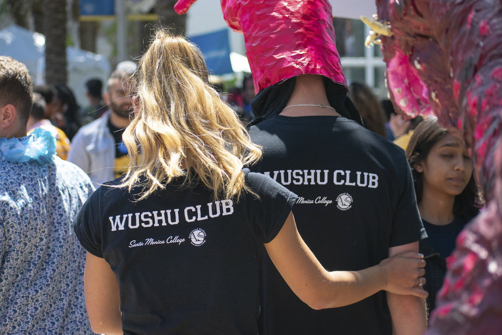 Members of the Wushu Club walk through the quad during Club Row at Santa Monica College on Thursday, April 26, 2018 in Santa Monica, California. With over 60 clubs in attendance, the day is meant to encourage clubs to showcase what they've been doing over the semester for students. (Ethan Lauren/Corsair Photo)