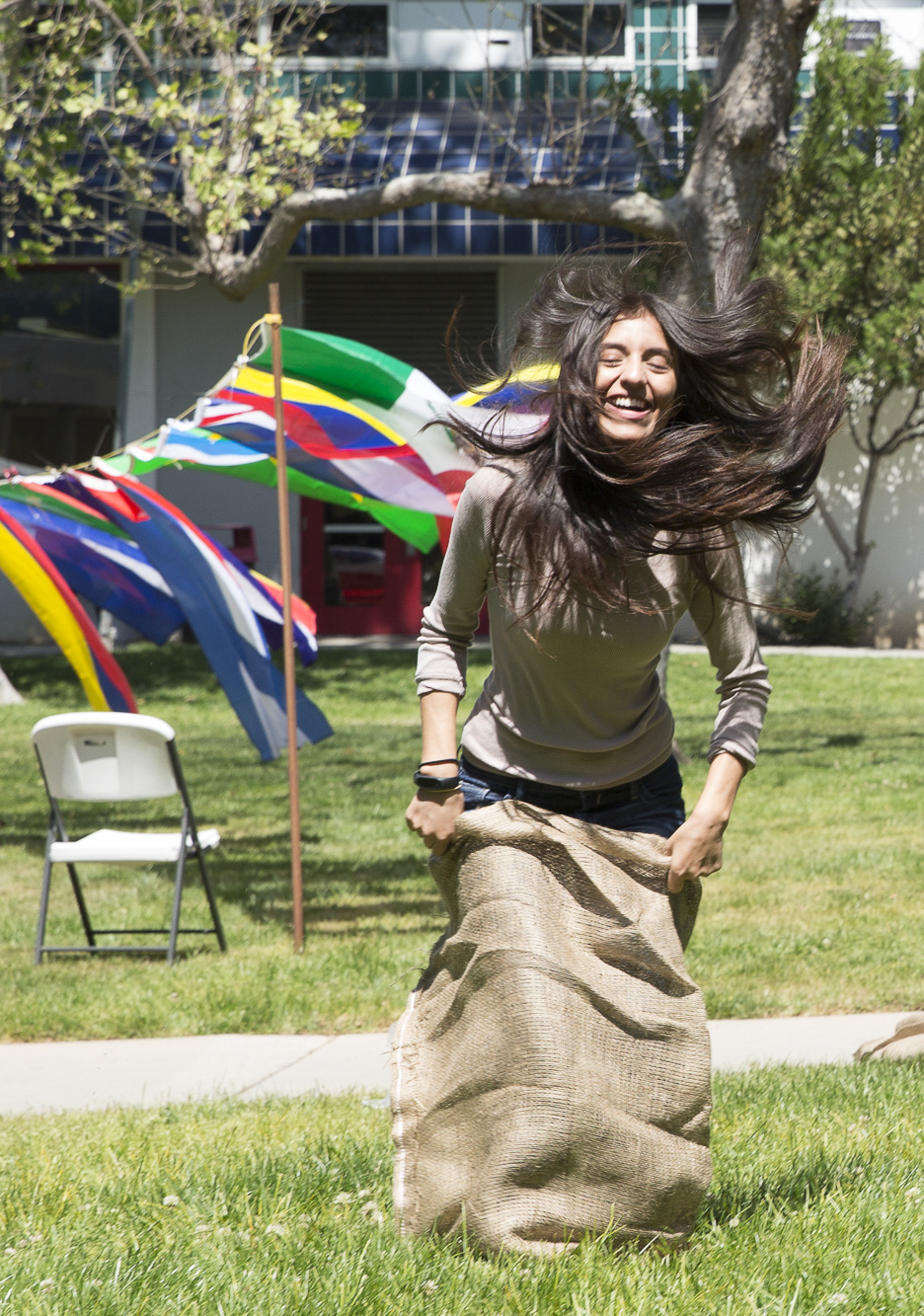 """The Cinco De Mayo celebration event that was hosted by the Santa Monica College (SMC) club """"Adelante"""" had many activities to take part in, including a potato sack race that took place in front of the SMC clock tower on the main campus in Santa Monica California on Thursday, May 3 2018. This event was put together by the Santa Monica College club """"Adelante,"""" whose goal at the event was to inform students about the origins of Cinco De Mayo and put to rest the stereotypes that come with the holiday, specifically the misperception that it is a day of independence for Mexico and also that is just a drinking holiday in the United States. (Matthew Martin/Corsair Photo)"""