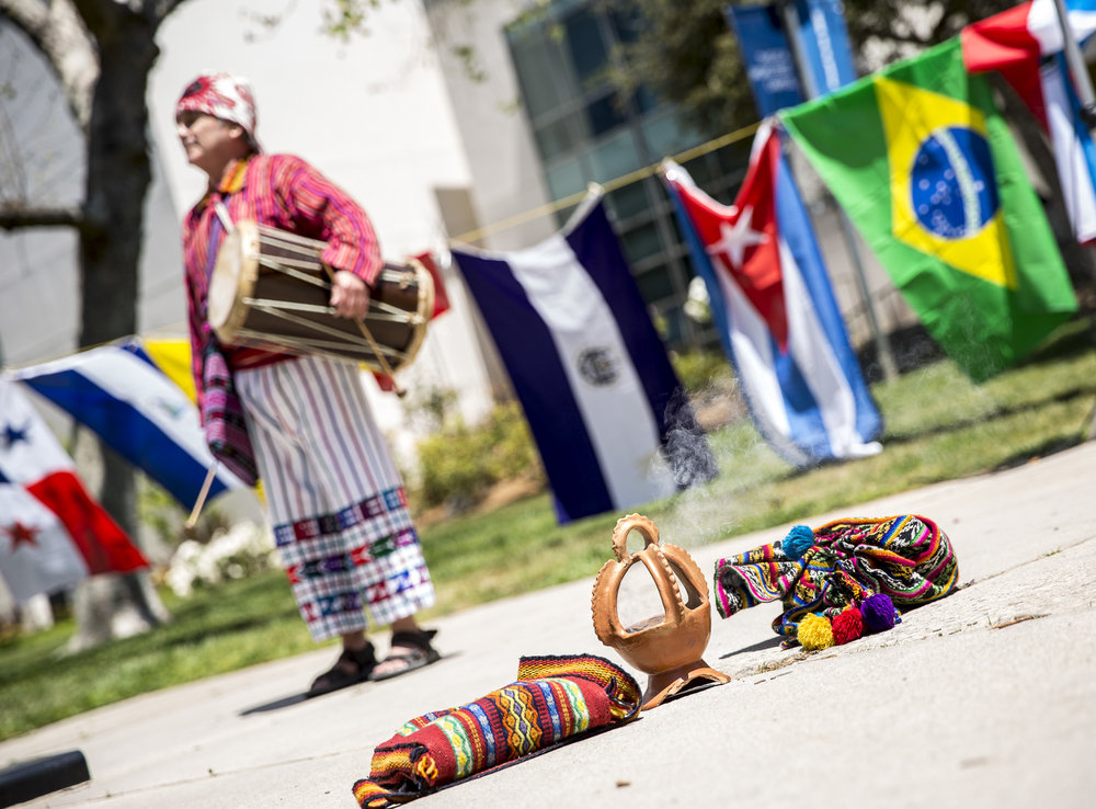 """A shot of Jorge Granja  who is apart of the group """"Folklore: Mi Bella Guatemala"""" prepares to begin a traditional Guatemalan dance for those attending the Santa Monica College (SMC) Cinco De Mayo celebration event in front of the clock tower on the SMC main campus on Thursday, May 3 2018.  This event was put together by the Santa Monica College club """"Adelante,"""" whose goal at the event was to inform students about the origins of Cinco De Mayo and put to rest the stereotypes that come with the holiday, specifically the misperception that it is a day of independence for Mexico and that it is just a drinking holiday in the United States. (Matthew Martin/Corsair Photo)"""