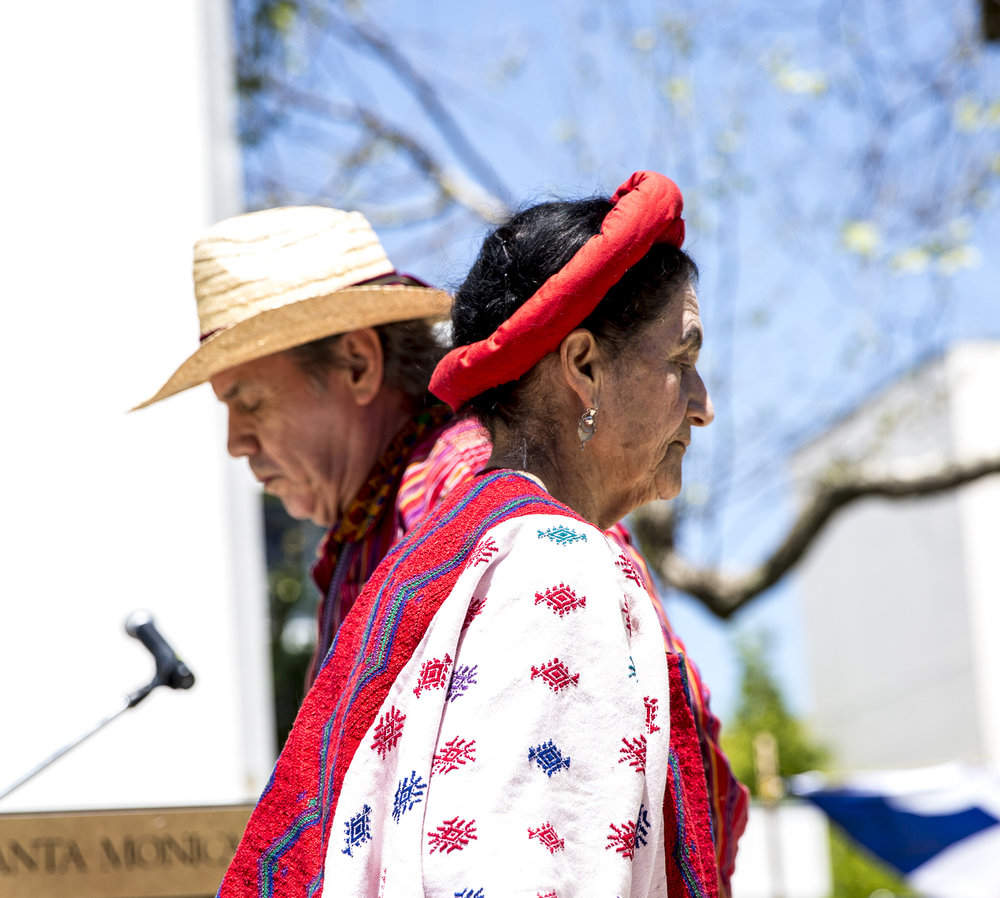 """Jorge Granja (behind facing left) and Evita Dubón (infront facing right), members of the group """"Folklore: Mi Bella Guatemala"""", perform a very slow dance that is native to the country of Guatemala during the Santa Monica College Cinco De Mayo celebration event in front of the clock tower on the SMC main campus on Thursday, May 3 2018.  This event was put together by the Santa Monica College club """"Adelante,"""" whose goal at the event was to inform students about the origins of Cinco De Mayo and put to rest the stereotypes that come with the holiday, specifically the misperception that it is a day of independence for Mexico and also that is just a drinking holiday in the United States. (Matthew Martin/Corsair Photo)"""