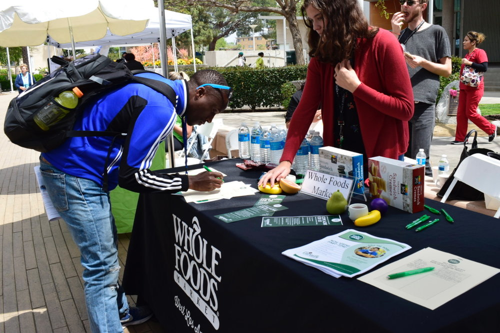 A Santa Monica College student signing up to get more information on job opportunities at Whole Foods during the Job Fair at Santa Monica College on May 8, 2018 in Santa Monica, Calif. (Claudia Vardoni/ Corsair Photo)