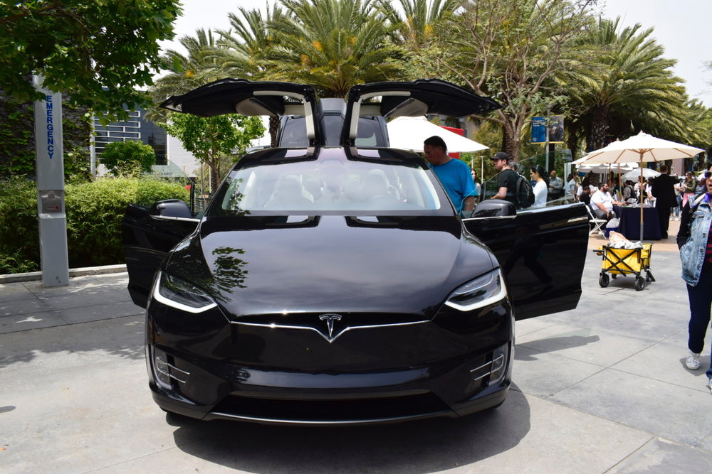 The Tesla car that was brought onto campus and drew a lot of attention during the Job Fair at the Santa Monica College quad on May 8, 2018. Students could try to sit in the Tesla while talking to the Tesla representatives about opportunities at their company. (Claudia Vardoni/ Corsair Photo)