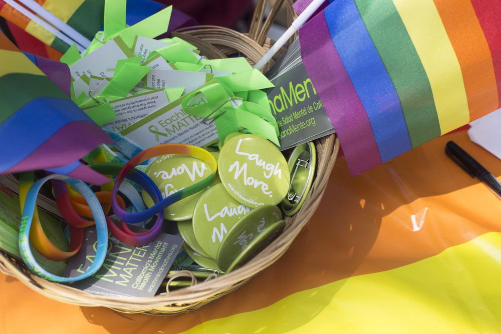Basket full of souvenirs guests could take home with them after attending the sSanta Monica College pride week event on main campus, Tuesday May 15. Tables we full of accesories, bracelets, pride flags, and buttons. Santa Monica College. Santa Monica, California. May 15 2018. (Fernanda Rivera, Corsair photo).