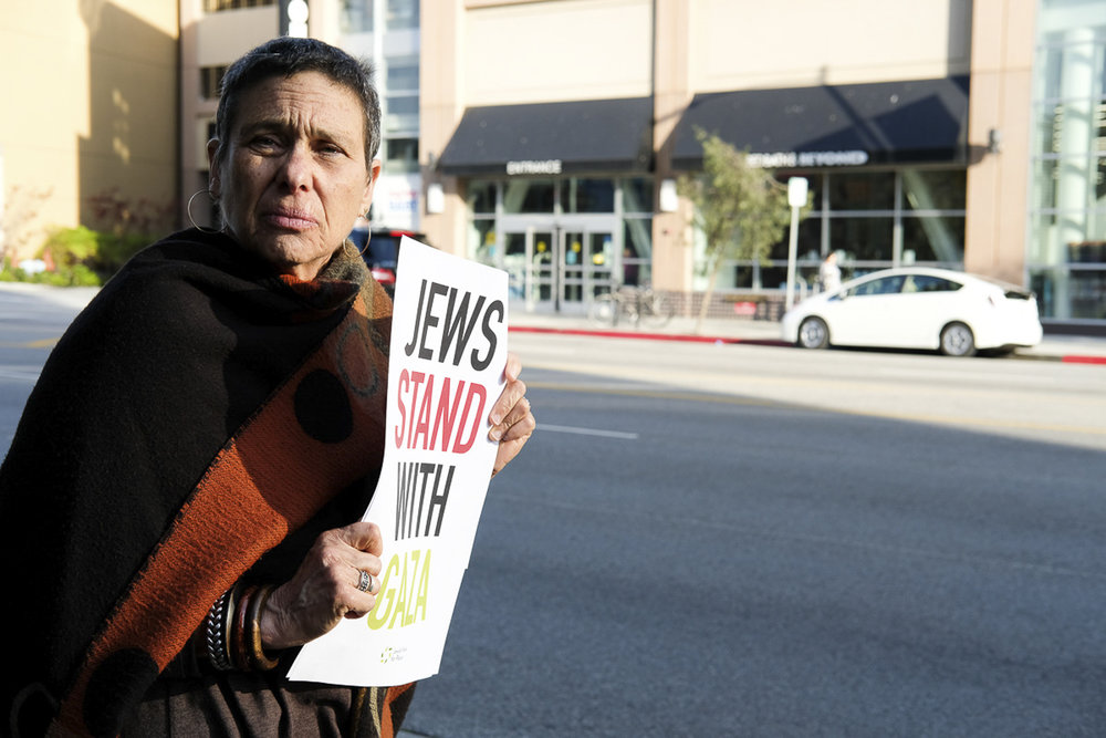 """Standing on Olympic Blvd holding a sign that states """"Jews Stand with Gaza"""" in Santa Monica, California on May 18, 2018. (Jayrol San Jose/Corsair Contributor)"""