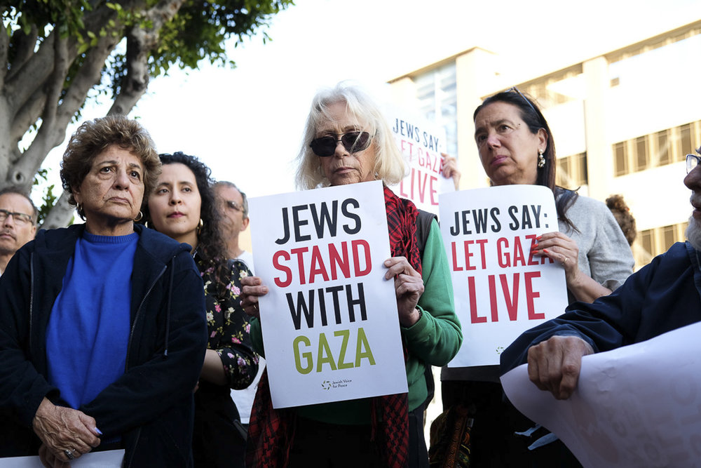 Attendees hold signs and listen in at the Vigil for Gaza in Santa Monica, California on May 18, 2018.  (Jayrol San Jose/Corsair Contributor)