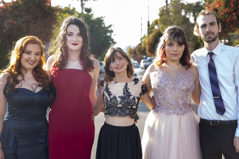 (From left to right) Kate Babbe, Nicole Johnson, Sarah Zeitzew, Amy Woodfine, and Tony Hokenson have a group photo taken before the annual LGBTQ+ Prom outside of the tinterfaith Church in Ocean Park in Santa Monica California on Friday May 18, 2018. (Matthew Martin/Corsair Photo)