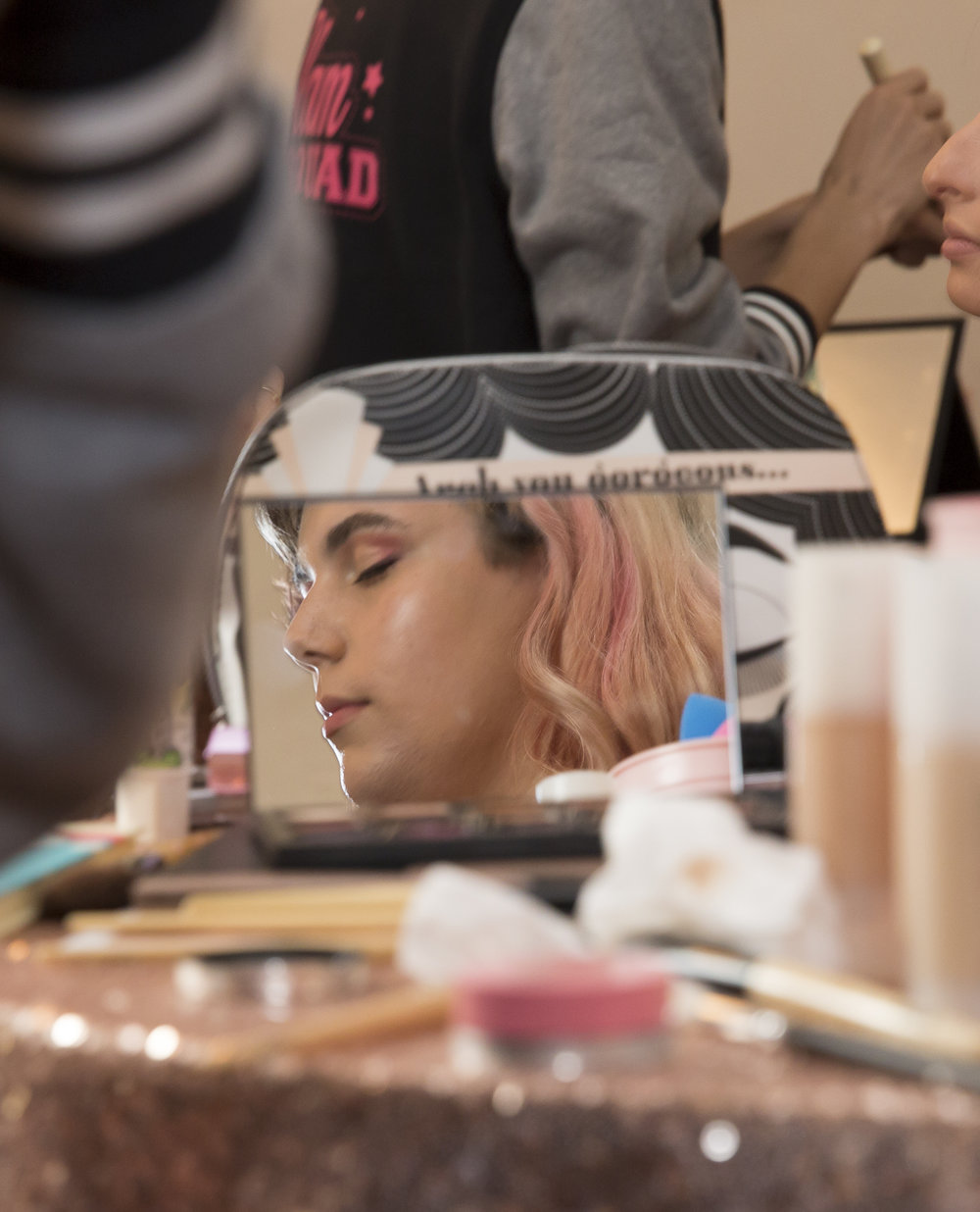 "Amy Woodfine's reflection in a makeup mirror as she is getting her makeup done before attending the LGBTQ+ Prom being held at the interfaith Church in Ocean Park in Santa Monica California on Friday May 18, 2018. The interfaith church has held ""Queer Proms"" in the past, but this year was the first that the prom's sponsor, Young People Creating Change (YPCC), partnered with the Princess Project Los Angeles (PPLA), Benefit Cosmetics, and Teen Vogue to produce the event. (Matthew Martin/Corsair Photo)"