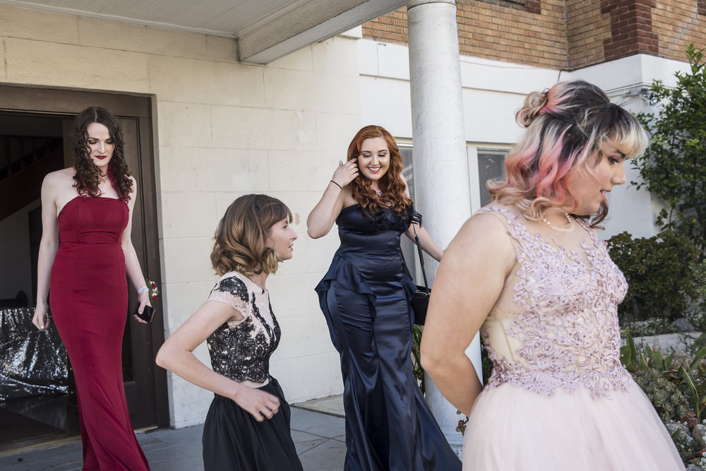 "(from left to right) Nicole Johnson, Sarah Zeitzew, Kate Babbe, and Amy Woodfine come outside to take prom photos together after getting their hair and makeup done, courtesy of Benefit Cosmetics, at the interfaith Church in Ocean Park in Santa Monica California on Friday May 18, 2018. The interfaith church has held ""Queer Proms"" in the past, but this year was the first that the prom's sponsor, Young People Creating Change (YPCC), partnered with the Princess Project Los Angeles (PPLA), Benefit Cosmetics, and Teen Vogue to produce the event. (Matthew Martin/Corsair Photo)"