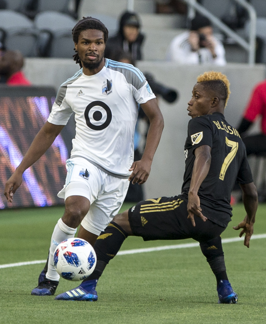 Minnesota United Football Club (MUFC) defender Carter Manley (2, left) manuevers around Los Angeles Football Club (LAFC) forward Latif Blessing (7, right) during their match at Banc of California Stadium on May 9, 2018 where the LAFC won 2-0. (Zane Meyer-Thornton/Corsair Photo)