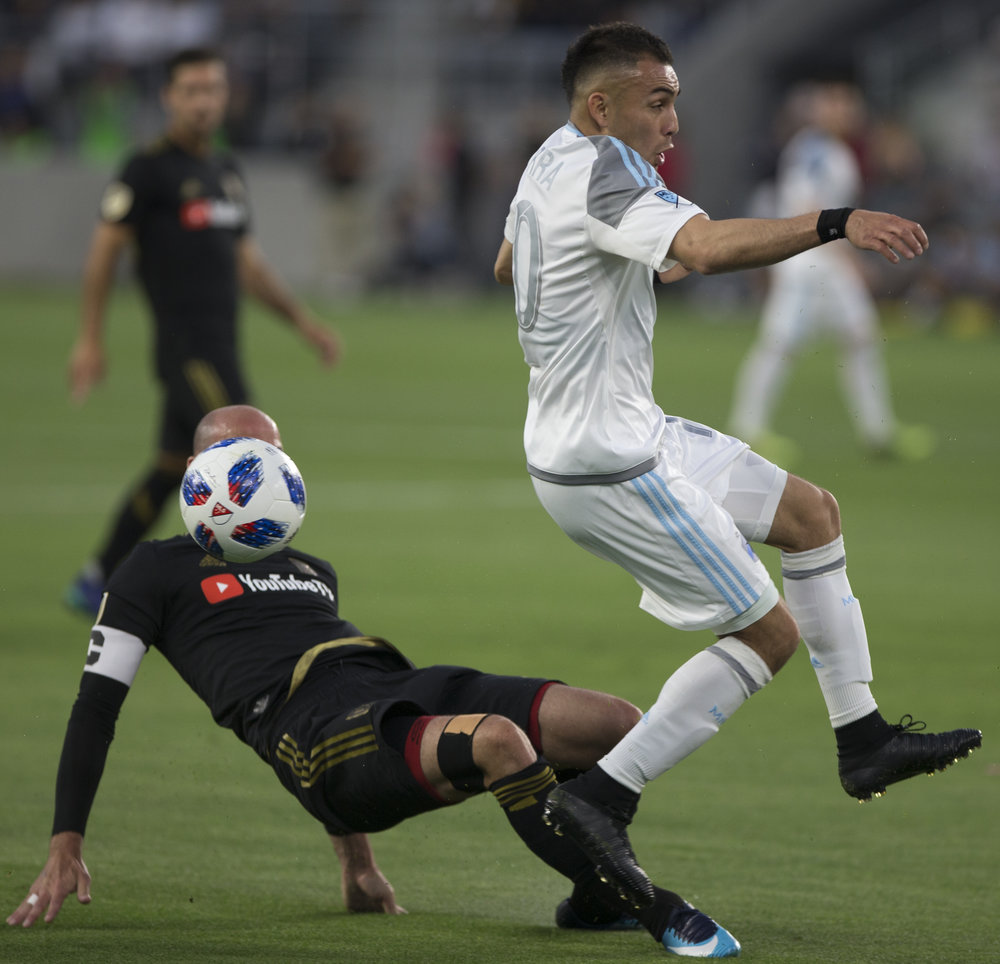 Los Angeles Football Club (LAFC) Captain defender Laurent Ciman (left) steals the ball from Minnesota United Football Club midfielder Miguel Ibarra (right) during their match at Banc of California Stadium on May 9, 2018 where the LAFC won 2-0. (Zane Meyer-Thornton/Corsair Photo)
