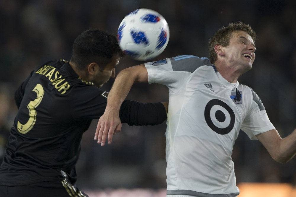 Los Angeles Football Club (LAFC) defender Steven Beitashour (3, left) headers the ball away from Minnesota United Football Club (MUFC) midfielder Collin Martin (right) during their match at Banc of California Stadium on May 9, 2018 where the LAFC won 2-0. (Zane Meyer-Thornton/Corsair Photo)