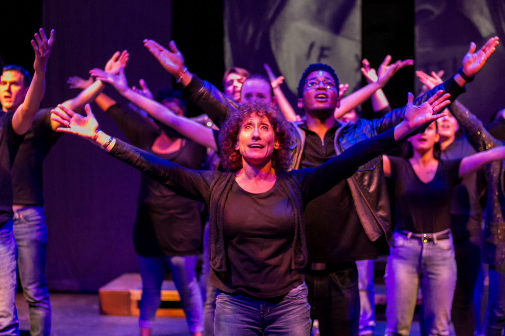 Sara Kaners sings with the cast of Voices of Hope as they shed light and give hope for victims of sexual assault and domestice violence. Dress rehearsal production was in the Santa Monica College's (SMC) Sound Stage Oct. 30, 2018. (Yasser Marte/Corsair Staff)