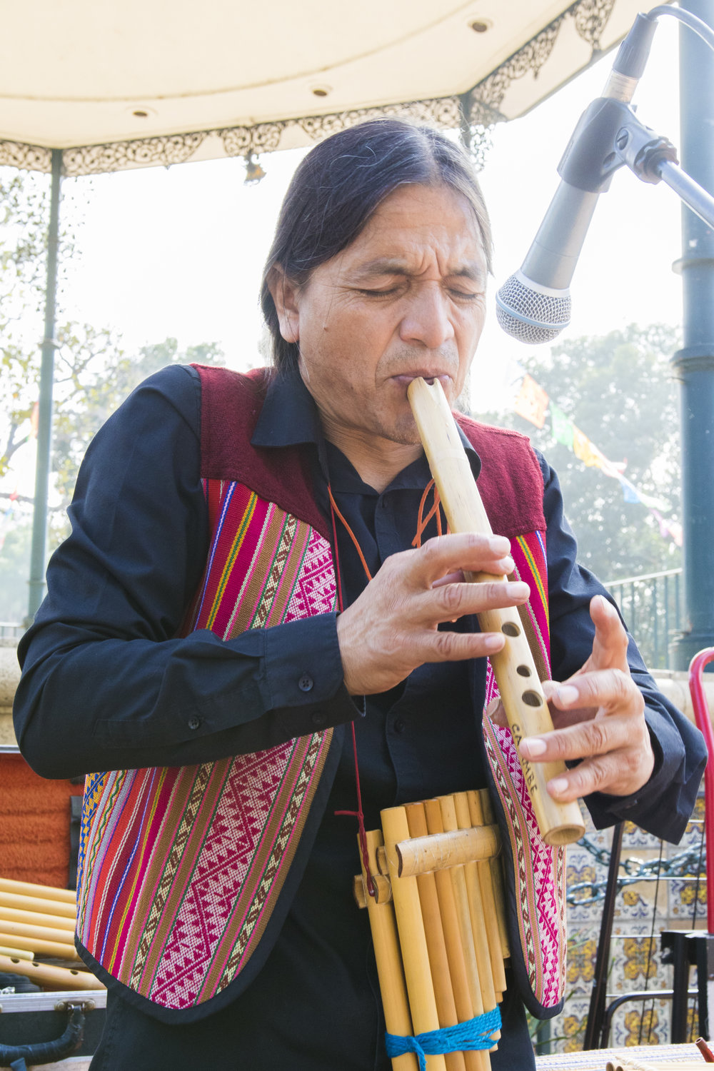 "Jonh Mosquera also known as ""Cayambe the Man from the Andes"" performs one of his originally composed songs to a small crowd on Olvera Street on October 29, 2018. Jonh has been selling his CD's on Olvera Street since the 1990's and has seen a dramatic decline in sales in recent years. However, he does not mind, because he makes music to be happy. It is not about the money for him. (Zane Meyer-Thornton/Corsair Photo)"