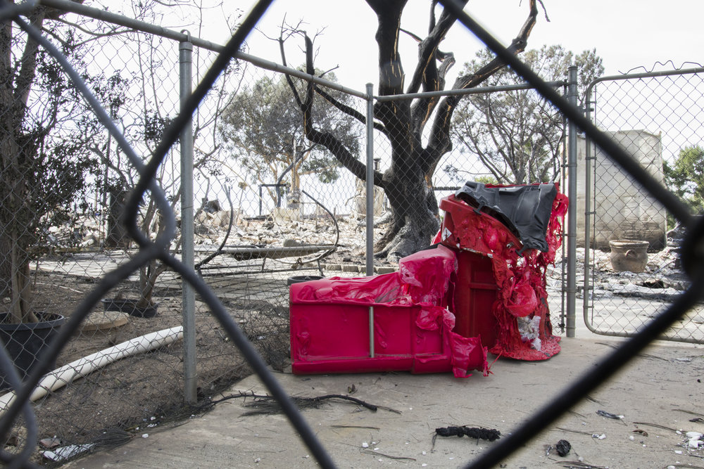 Melted trashcans sit outside of the remnants of a house burned to the ground by the Woolsey Fire in Malibu, California on November 13, 2018 (Zane Meyer-Thornton/Corsair Photo)