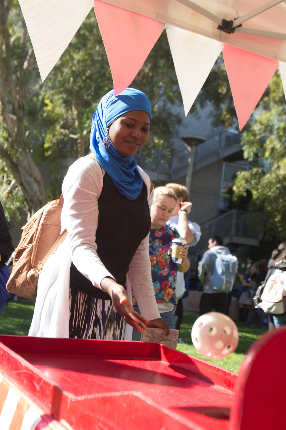 First year student, Sadia playing skee ball for the Active Minds event outside the quad area located at Santa Monica College in Santa Monica California on Tuesday November 13th, 2018. (Jacob Victorica/ Corsair Photo)
